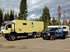 Man expedition vehicle from Europe in West Thumb Geyser parking lot in Yellowstone. We look very small