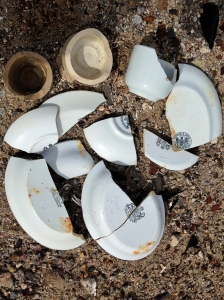 Broken china and beer bottles left at Belleville